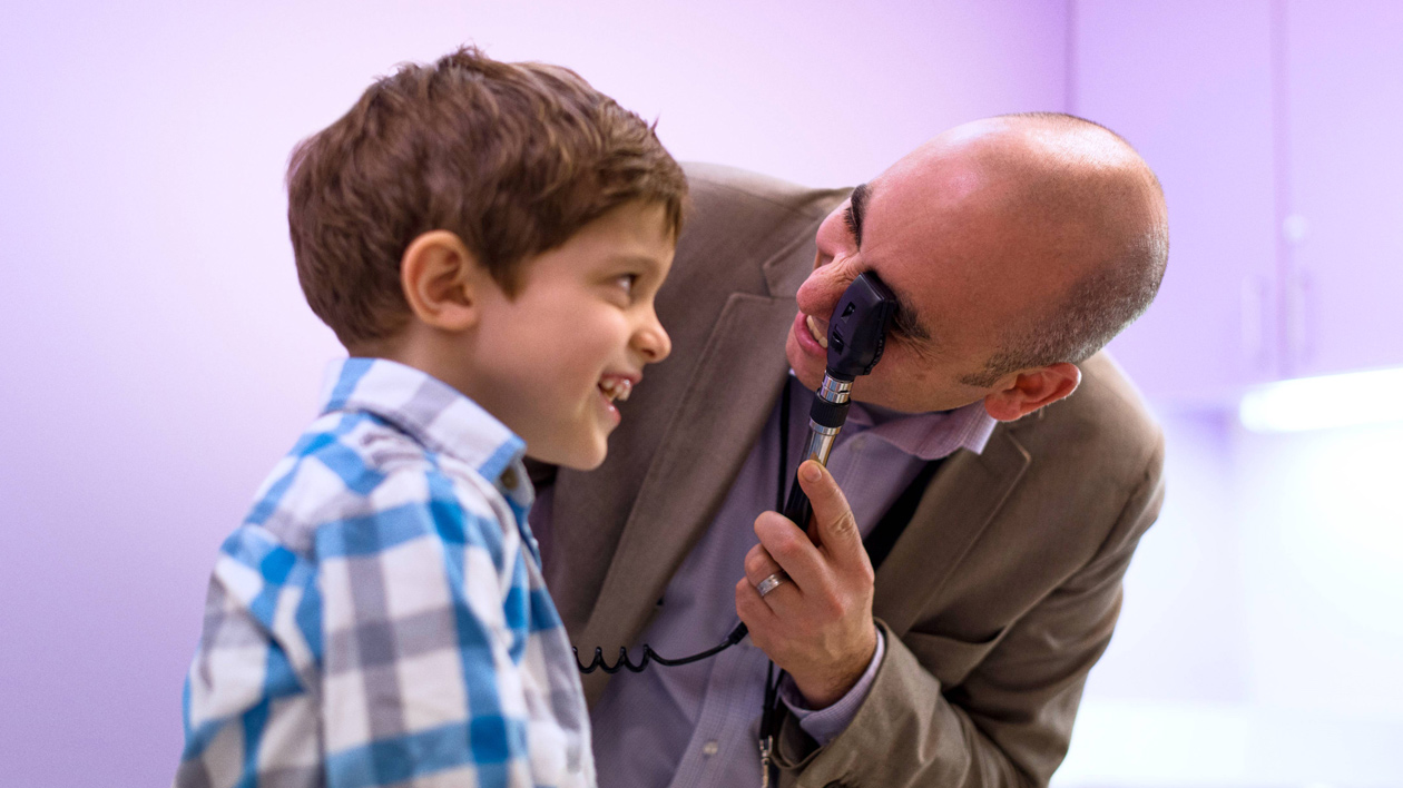Doctor Examines Pediatric Patient