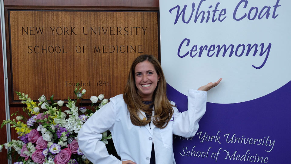 Allison after receiving her white coat at the NYU School of Medicine White Coat Ceremony.