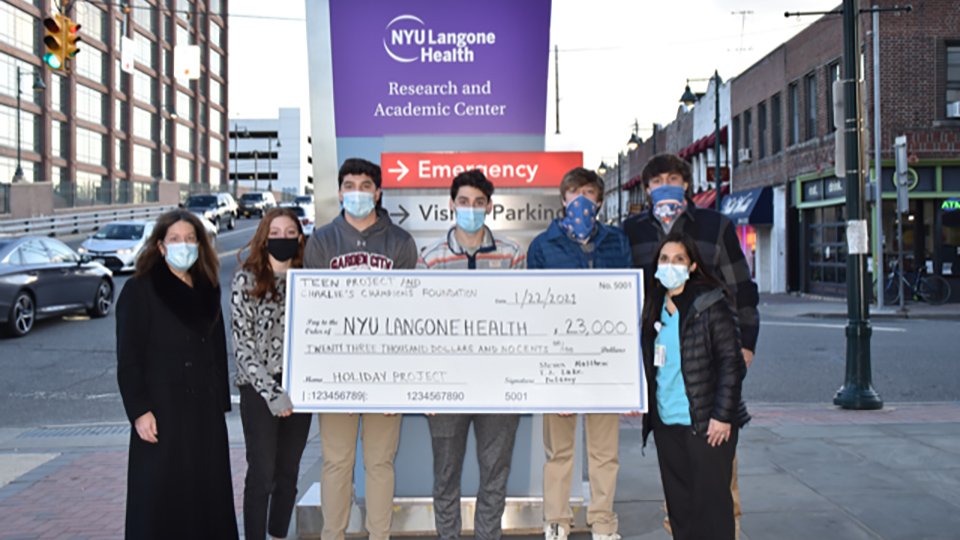 Check from the Teen Project and Charlie's Champions Foundation online fundraiser to NYU Langone Health