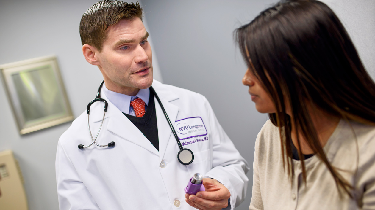 Doctor Speaking with Young Patient