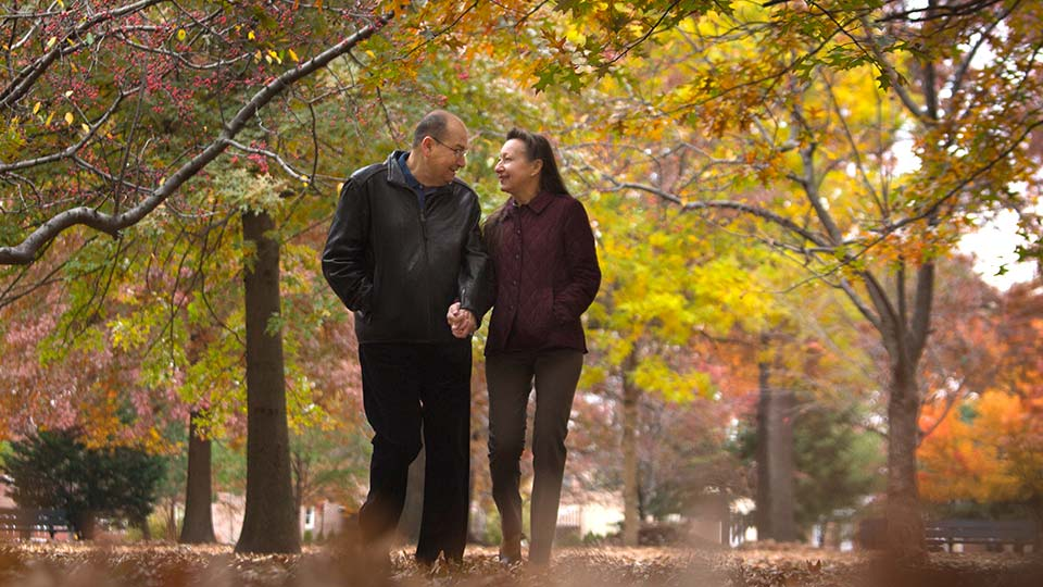 Couple Walking in Autumn Leaves