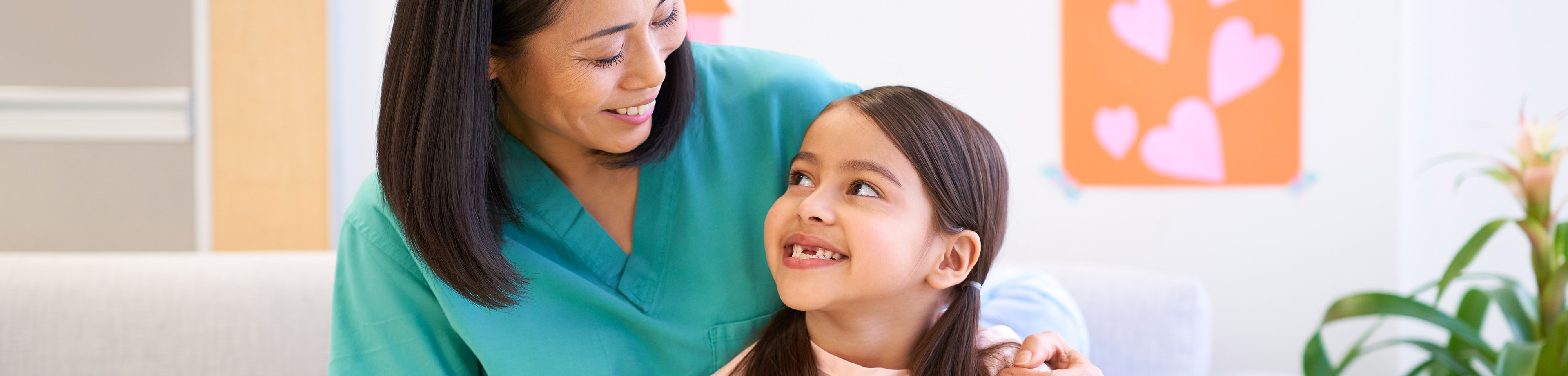 Caregiver with Pediatric Patient