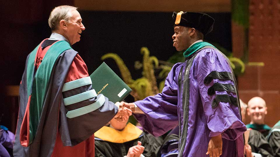 Dean and CEO Dr. Robert I. Grossman with Graduate