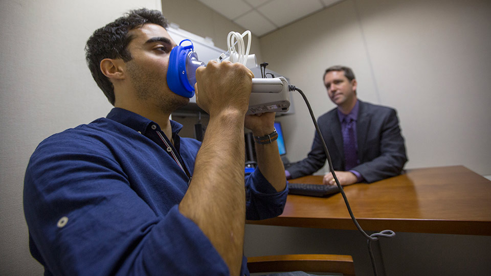 Doctor Tests Patient's Vocals with Device