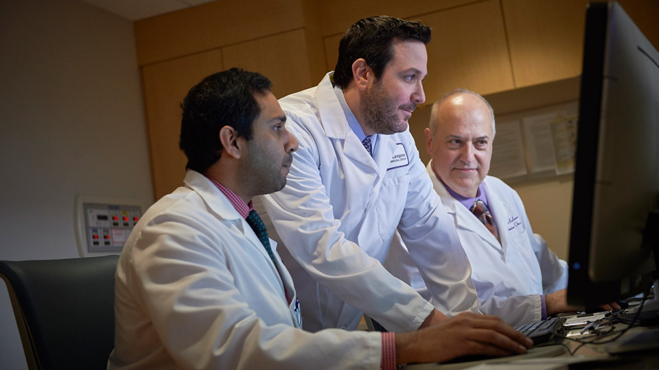 Radiation Oncologist Dr. Alec Kimmelman Reviews Images with Staff