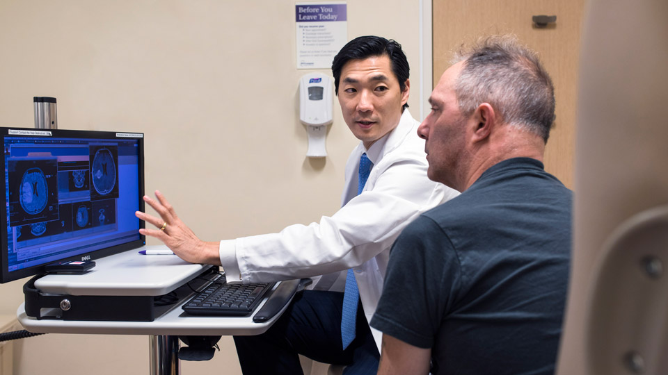 Dr. Andrew Chi Chats with Patient