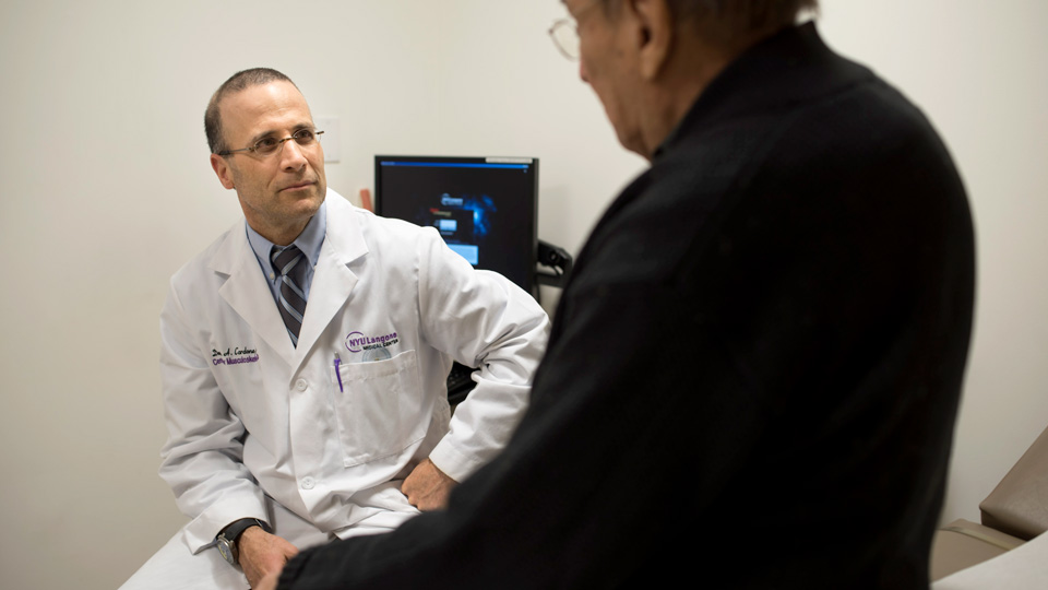 Dr. Dennis Cardone Speaks With a Patient