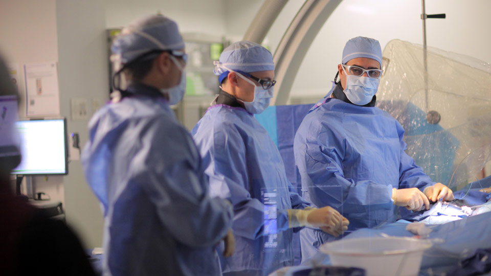 Dr. Howard Riina and Colleagues in Operating Room