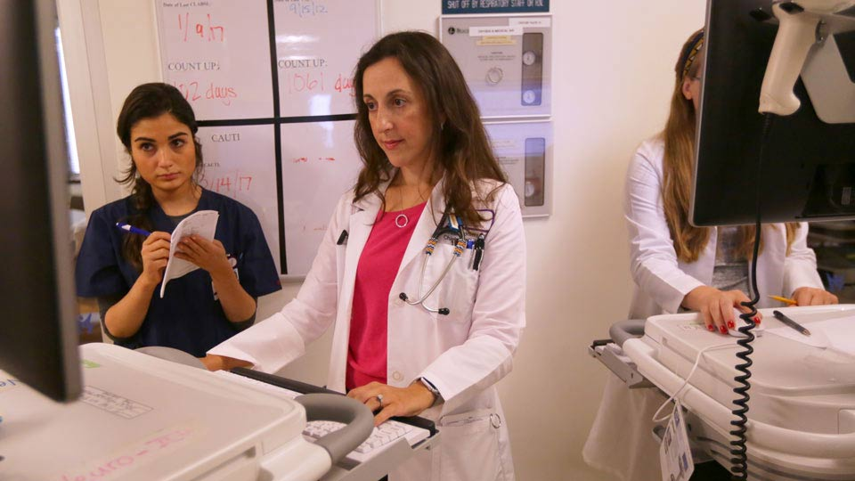 Dr. Jennifer Frontera Reviews a Patient's Chart