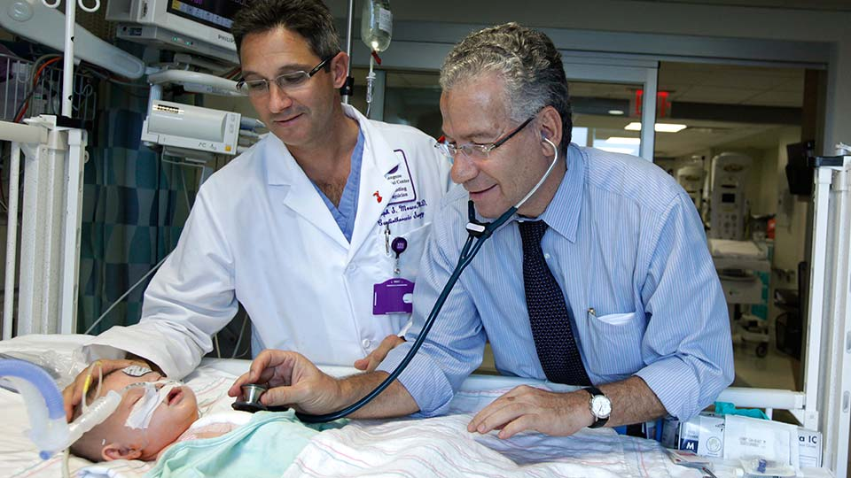 Drs. Ralph S. Mosca and Achiau Ludomirsky Check on PICU Patient