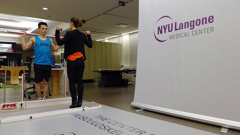 Exercise Physiologist Heather Milton and Athlete Doing Stability and Mobility Assessment