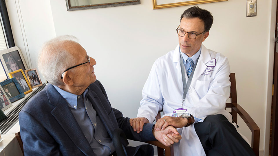 Geriatrician Dr. Michael Perskin Examines Elderly Patient