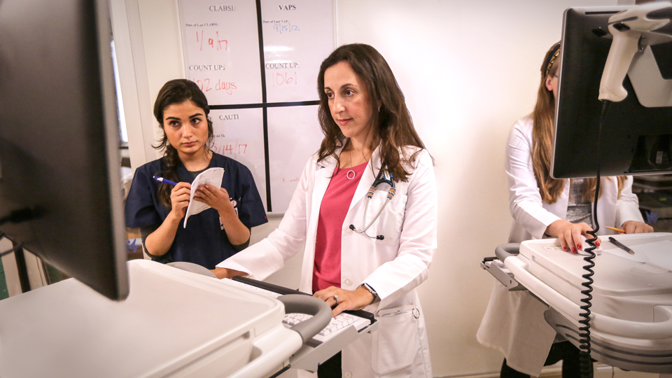 Dr. Jennifer Frontera Examines Patient's Test Results