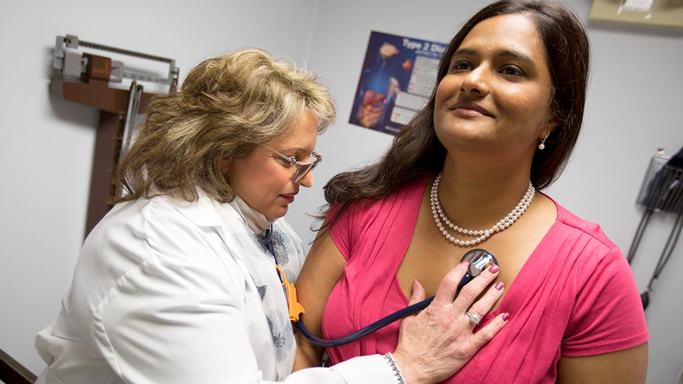 Internist Dr. Valerie J. Zarcone Examines Patient