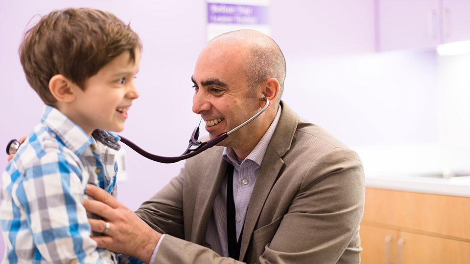 Neuro-oncologist Dr. Kaleb Yohay Examines Pediatric Patient