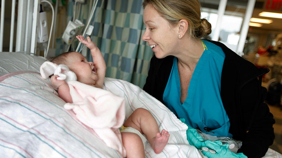 Nurse with Patient in Pediatric Intensive Care Unit