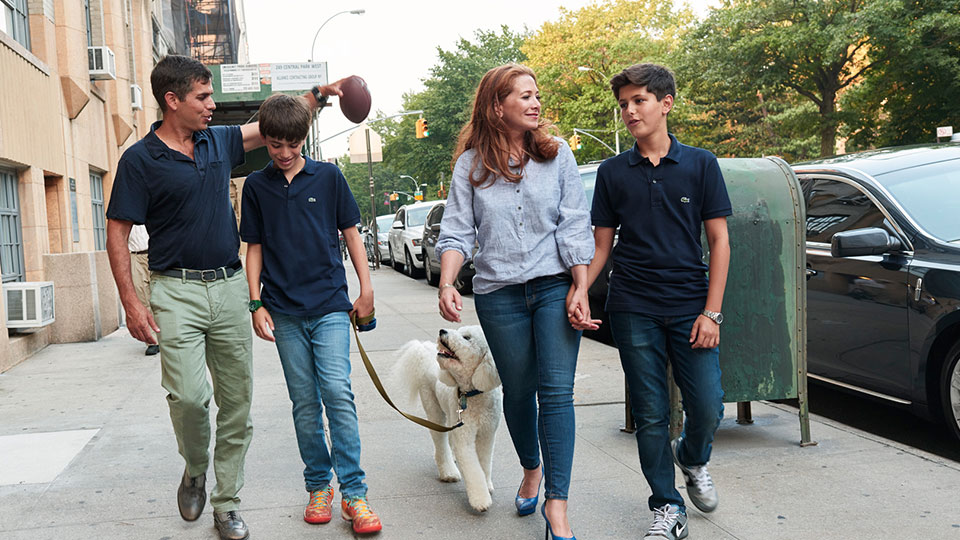 Andy, Jonah, Allyson, and Samson Wiener take a walk with their dog, Taco, near their home in the Upper West Side.