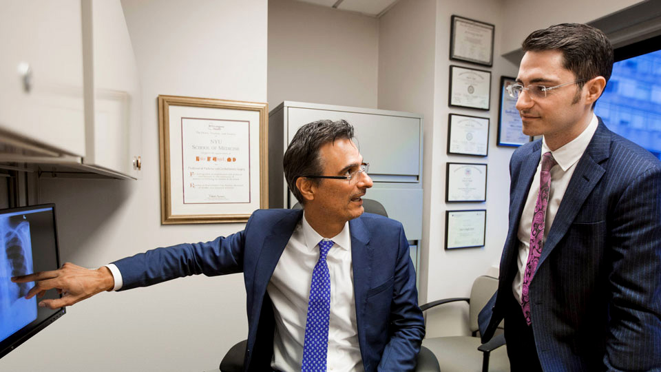 Dr. Luis F. Angel and Dr. Zachary N. Kon Discuss a Patient's Test Results