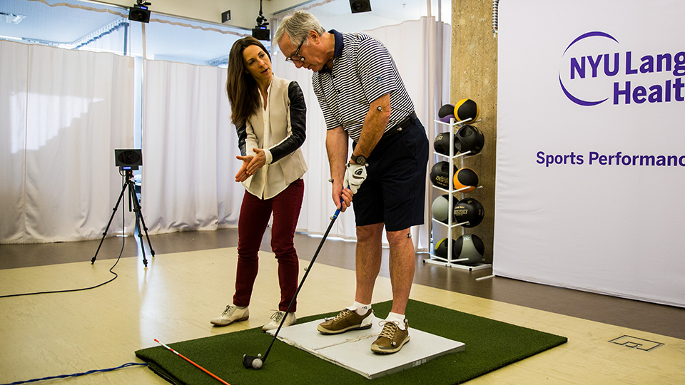 Exercise Physiologist Heather Milton Evaluates a Golfer at the Golf Lab