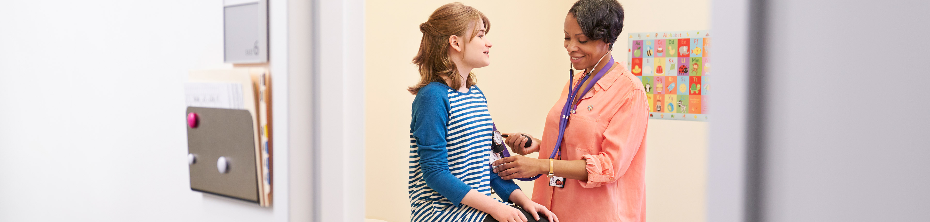 Doctor Checks Pediatric Patients Blood Pressure