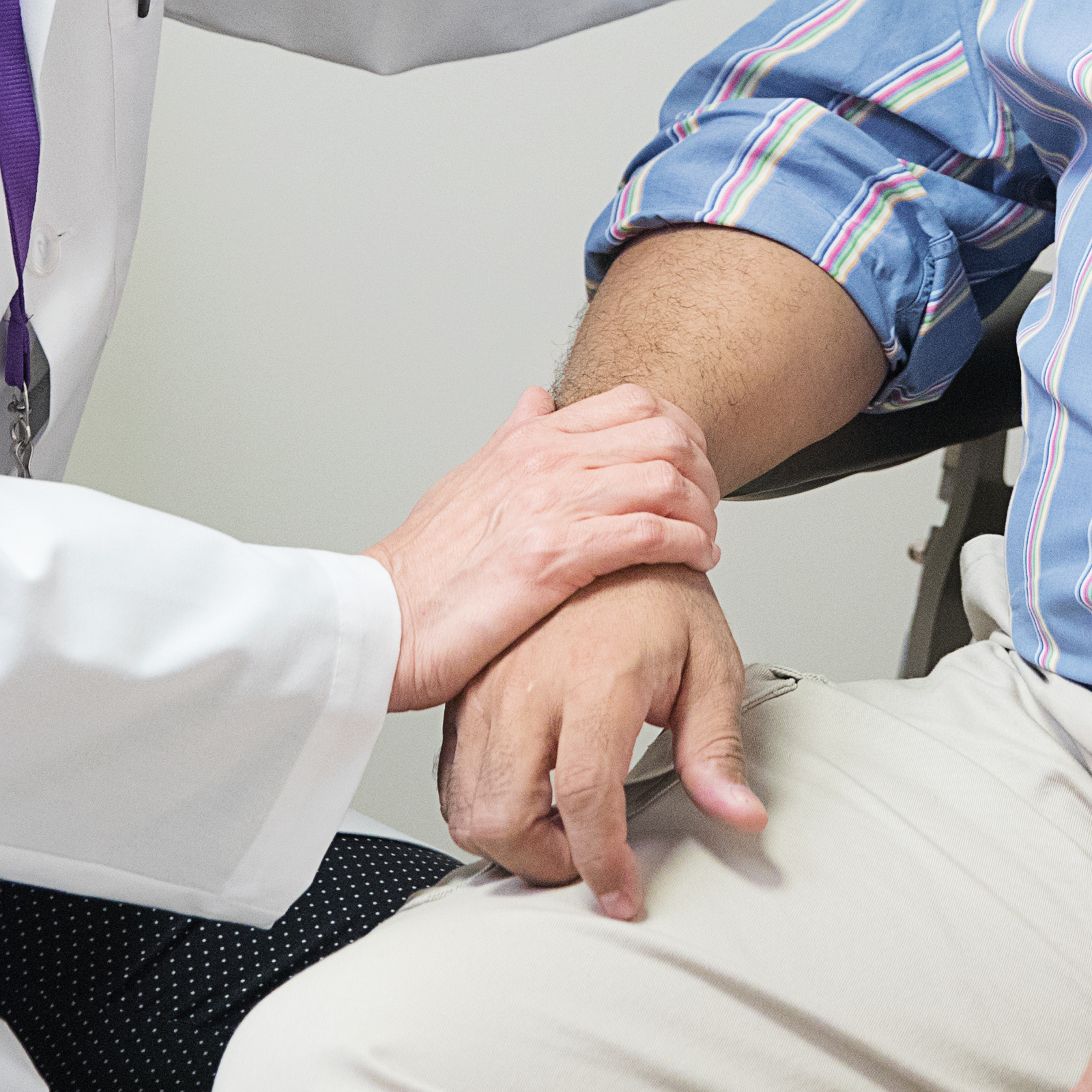 Doctor Touching Patient's Hand