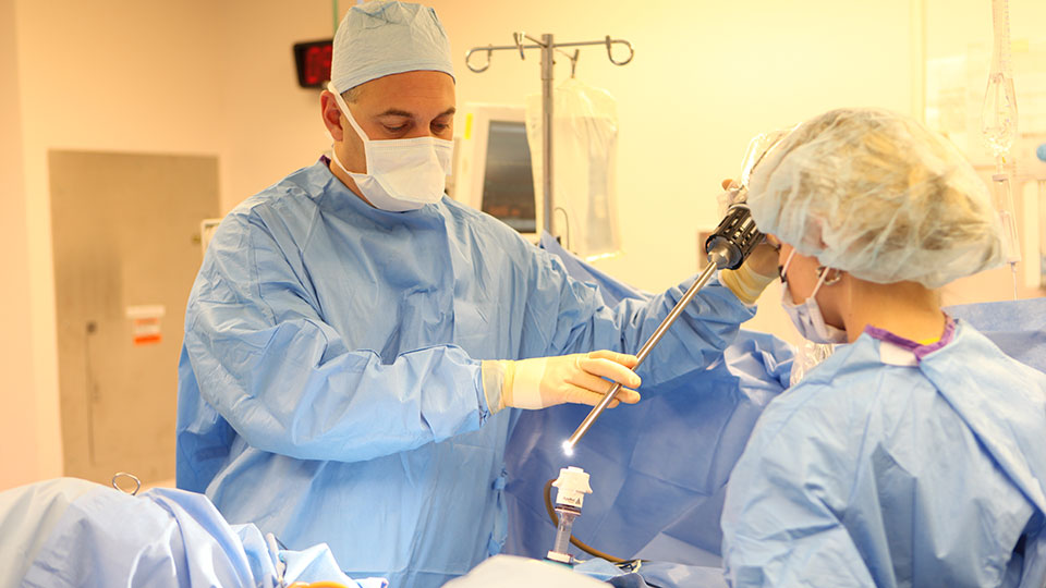 Surgeon Performs Robotic-Assisted Surgery