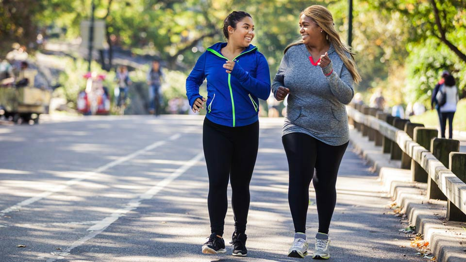 Two Women Running Outdoors