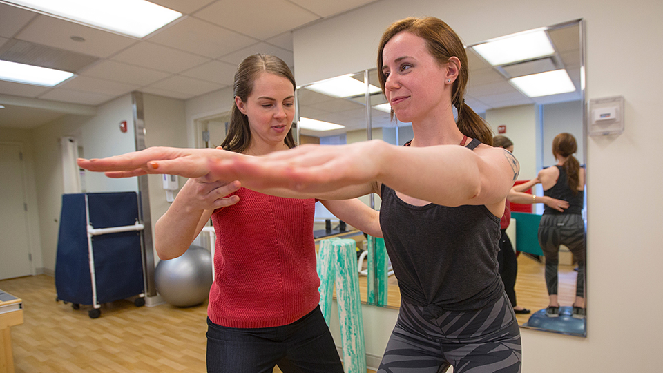 Physical Therapist Works with Patient