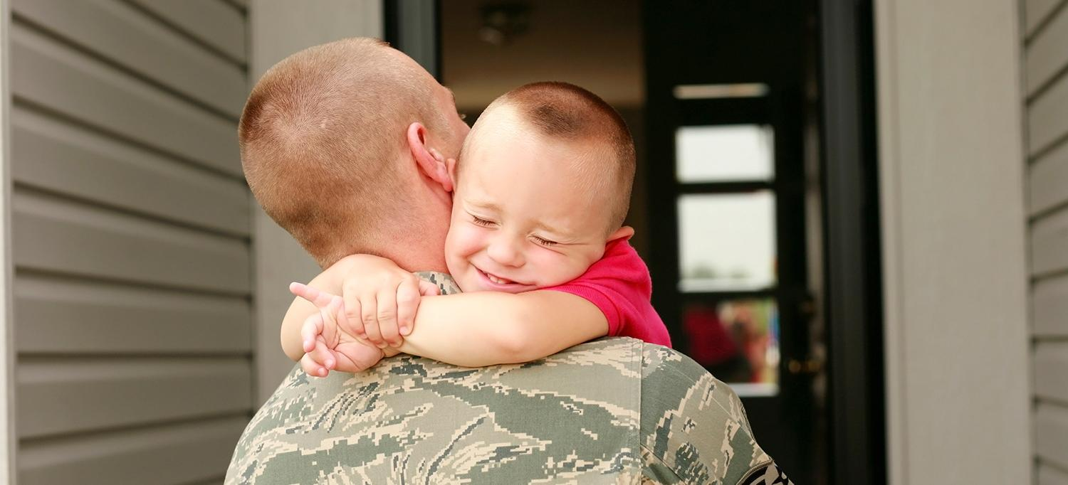 Child Hugs Father Returning from Military Duty