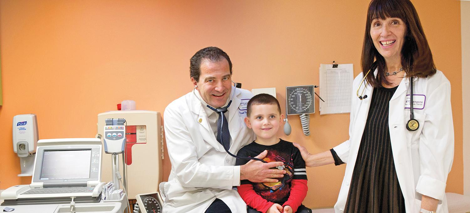 Dr. Frank Cecchin and Nurse Practitioner Sharda McGuire with Pediatric Patient