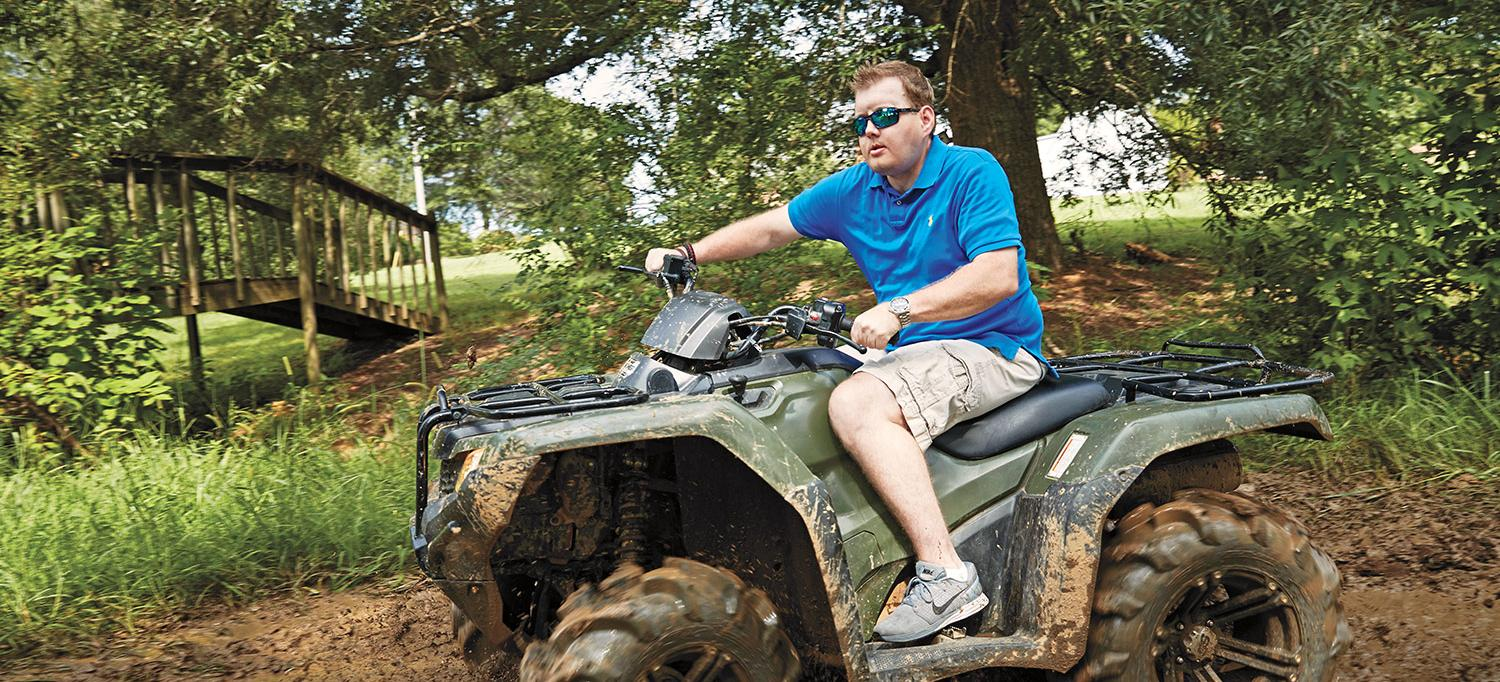 Patrick Hardison Rides an All-Terrain Vehicle