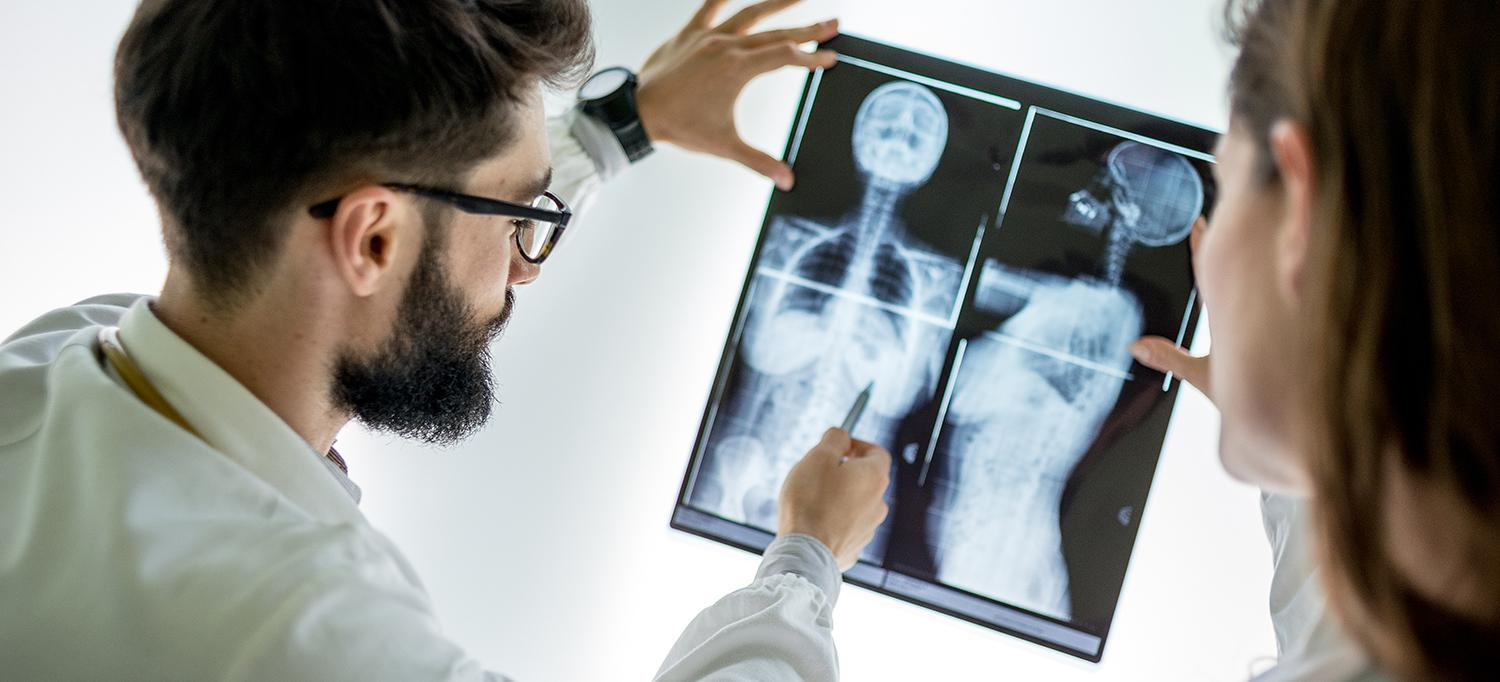 Doctor Studies an X-ray