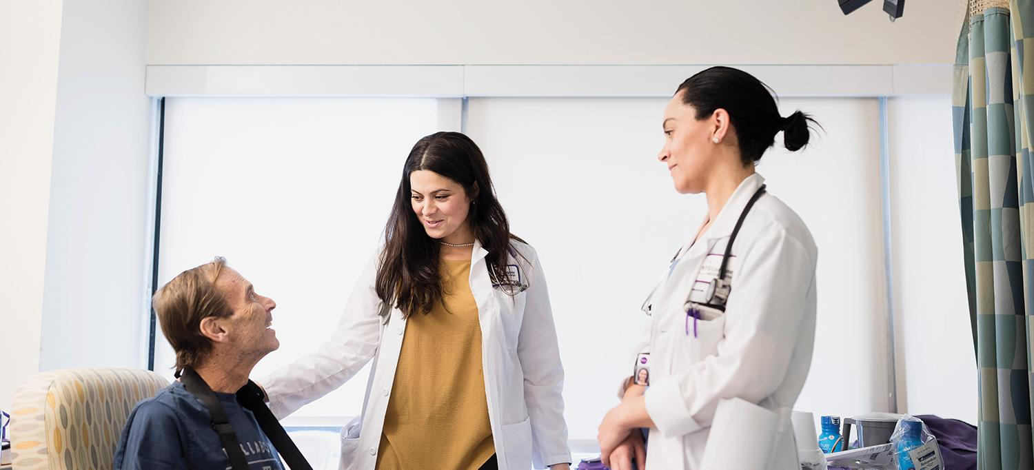 Sofiya Prilik, MD, and Francesca Toone, NP, Consult with a Patient