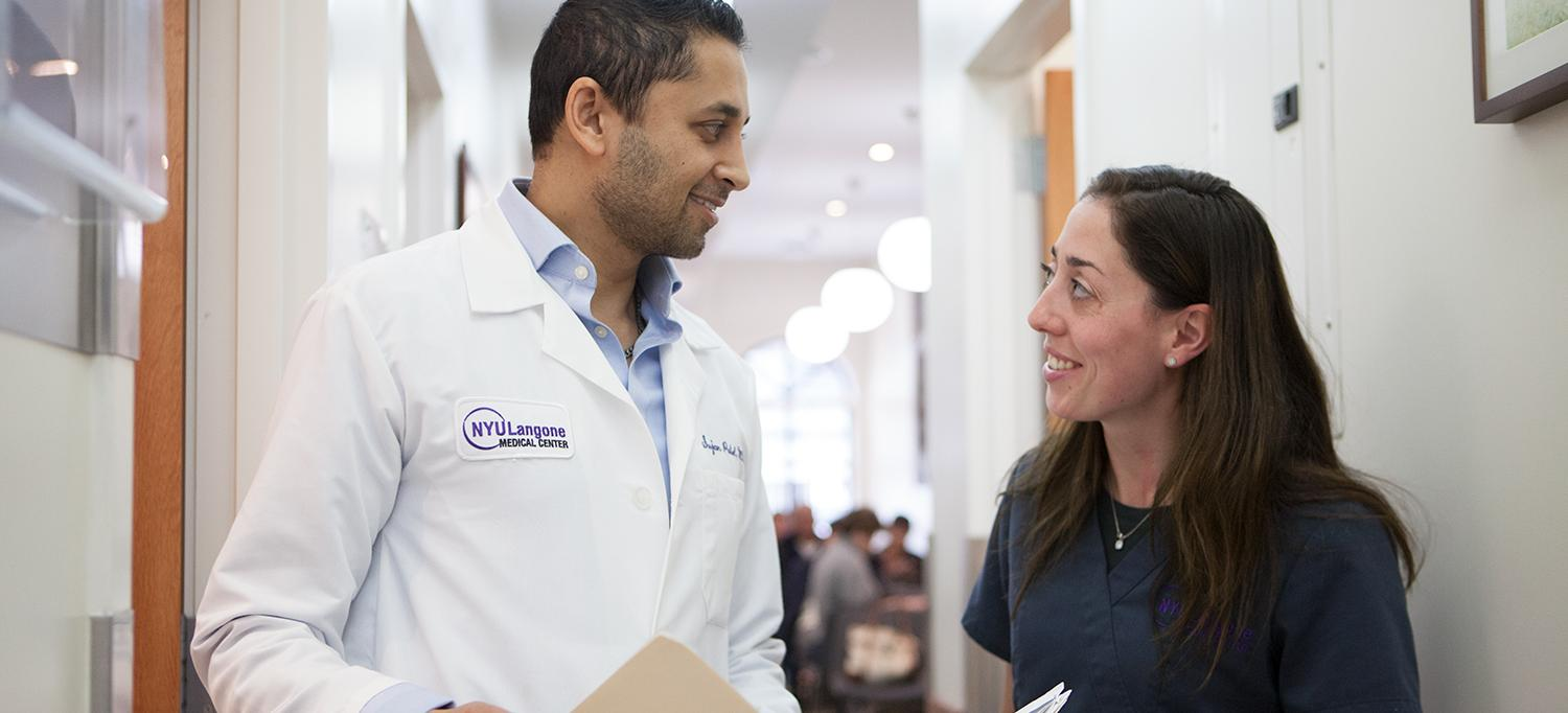 Dr. Sujan Patel Speaks with a Colleague
