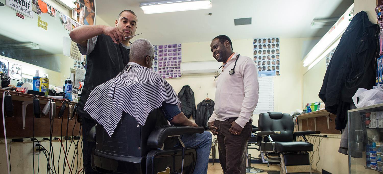 Dr. Joseph Ravenell Speaking with Man in Barbershop