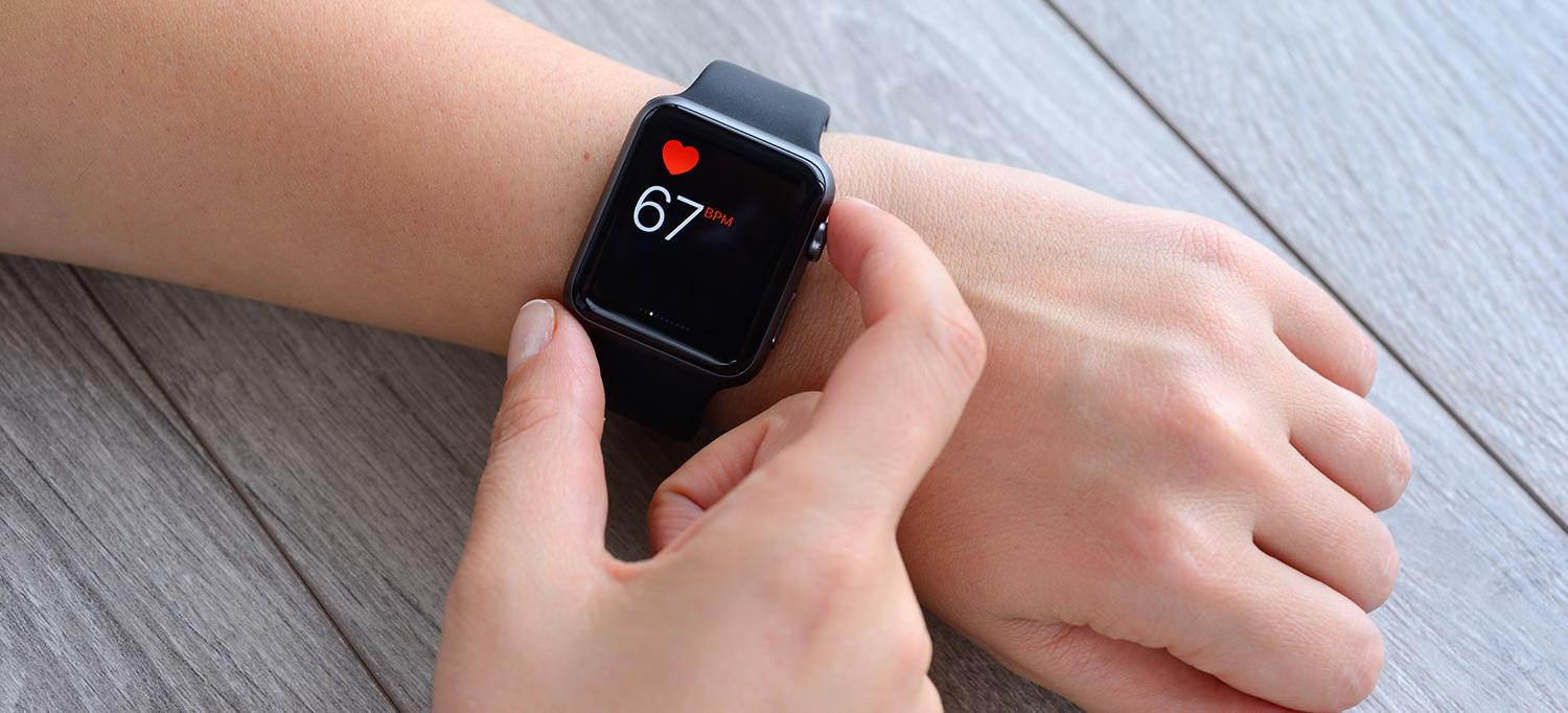 Person Checks Heart Rate on Smartwatch