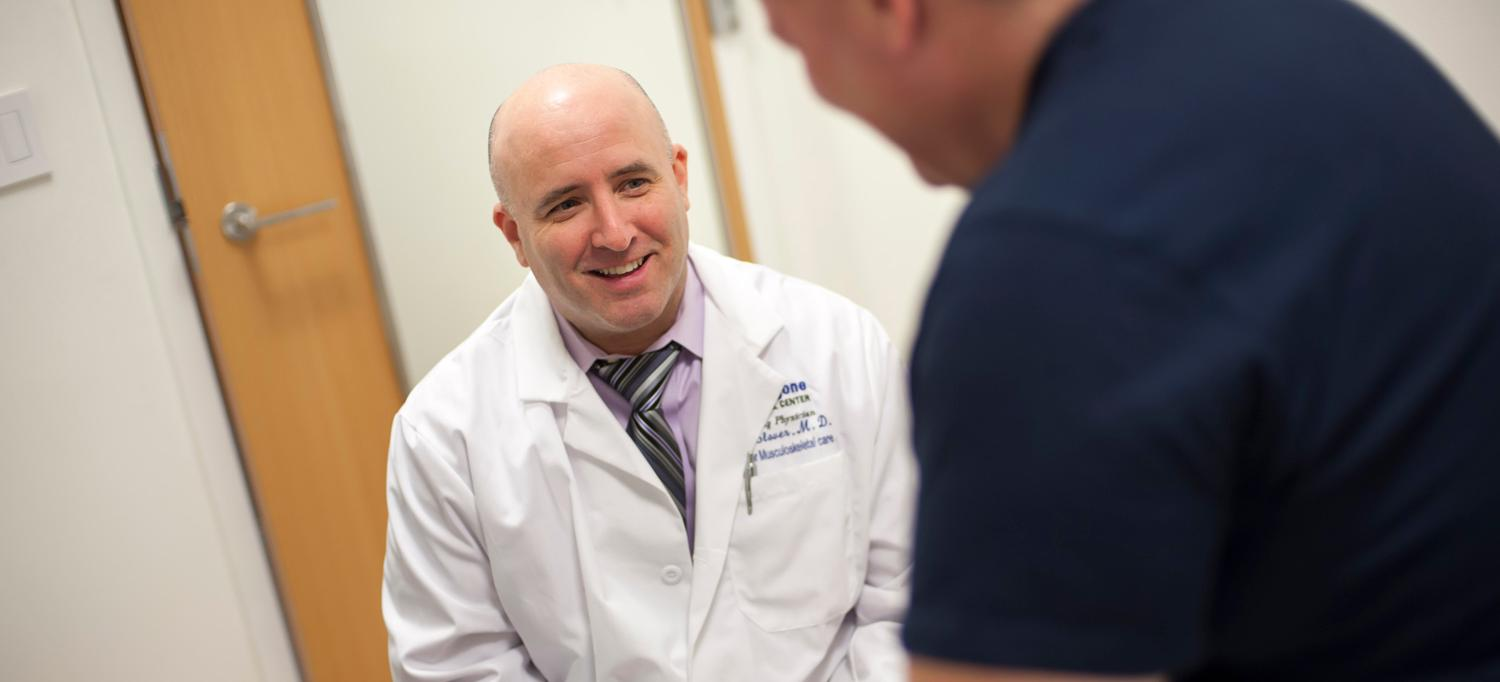 Dr. James D. Slover Speaking with a Patient