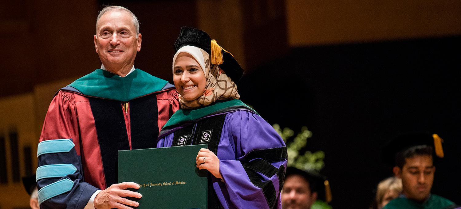 Dean Grossman with a Student at Graduation