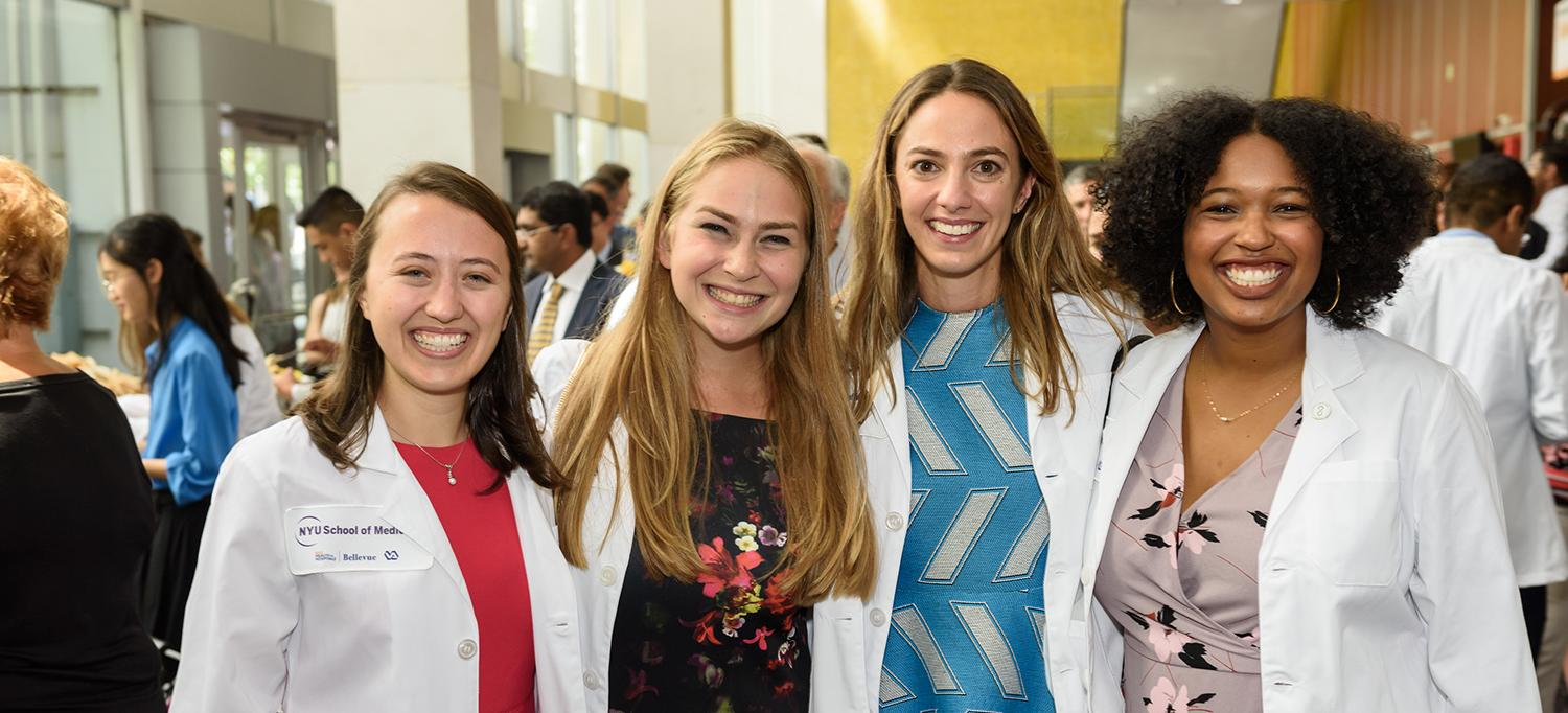 Four Medical Students in White Coats