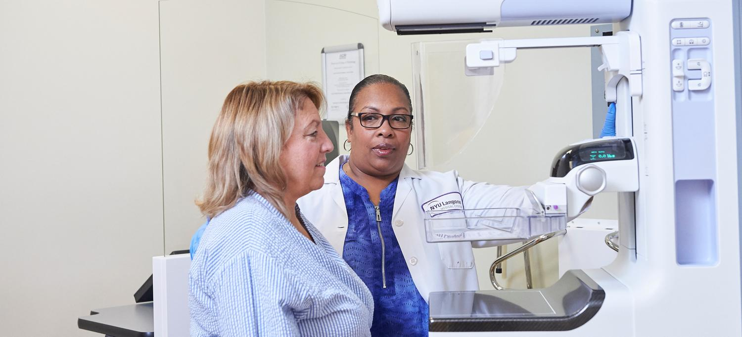 Mammogram Technician Preps Patient