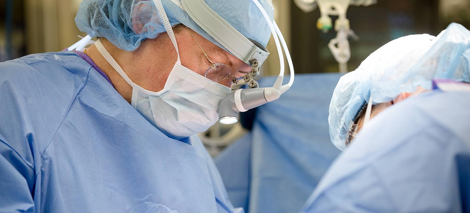 Dr. Robert Montgomery Performing Surgery