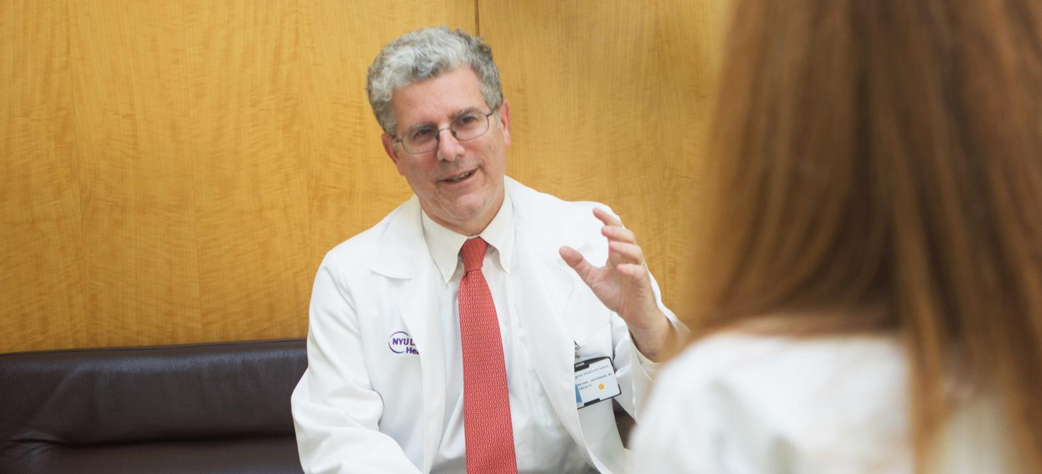 Dr. Michael L. Grossbard Talks with Patient