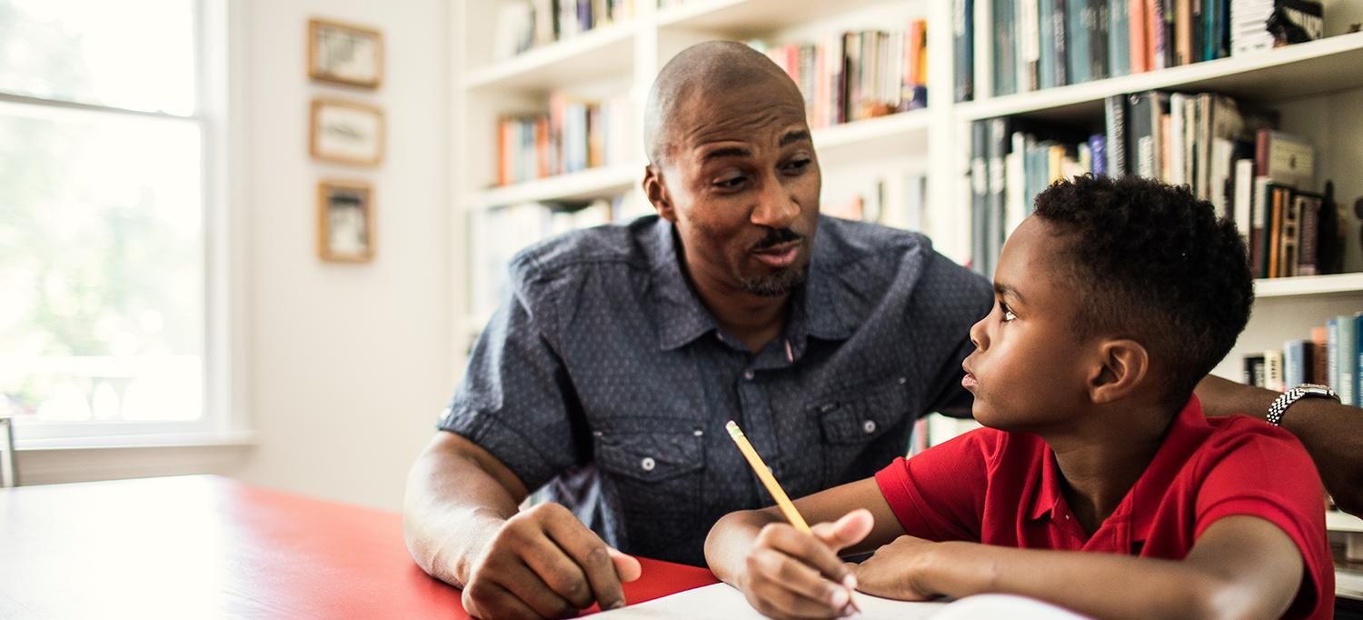 Man Helps Son with Homework
