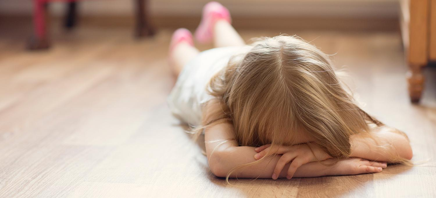 Child Lying Face Down on Floor