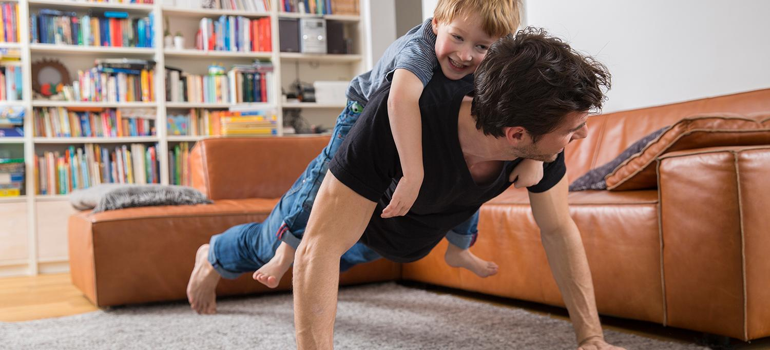 Man Does Push-Up with Child on Back