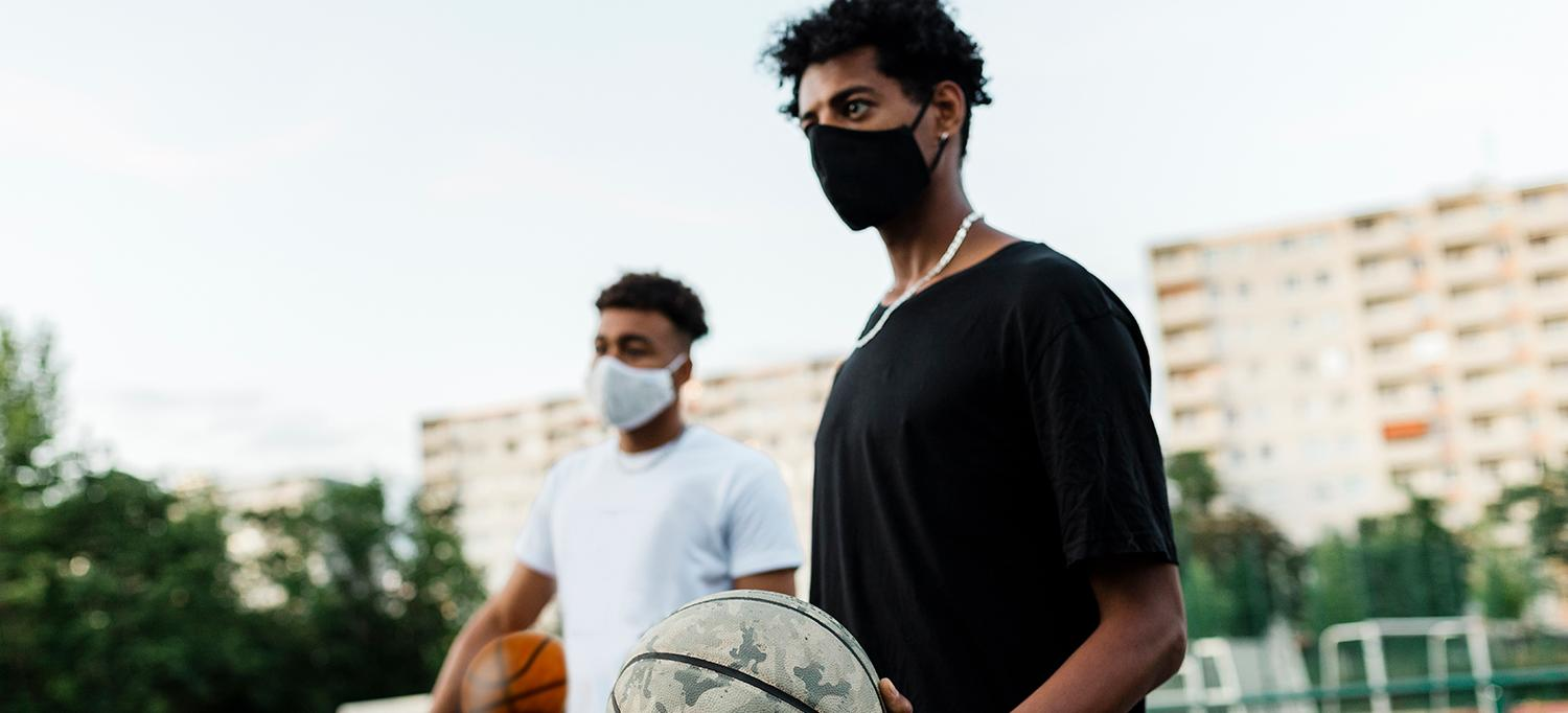 Young Men in Protective Masks with Basketballs in the Park