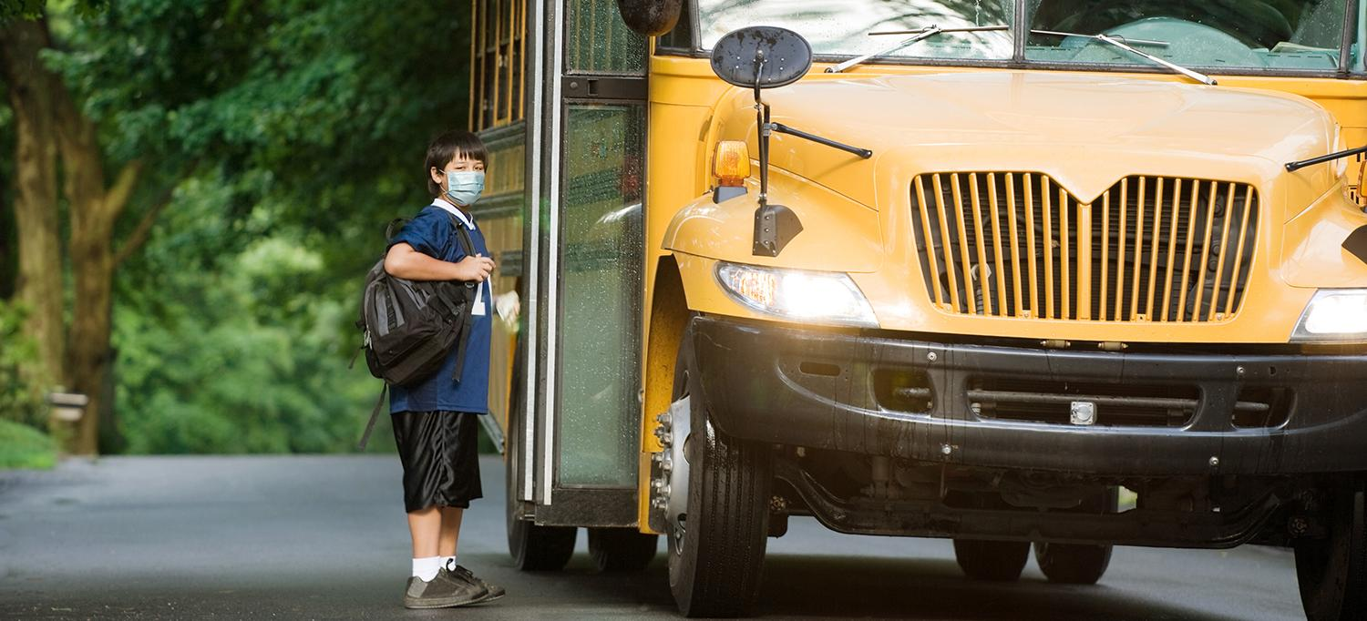 Child Wearing Face Mask Boarding School Bus