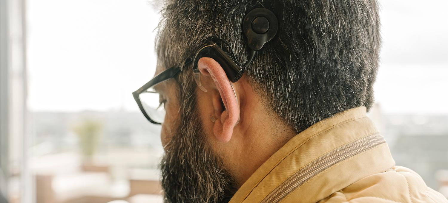 Person with Cochlear Implant on Left Ear